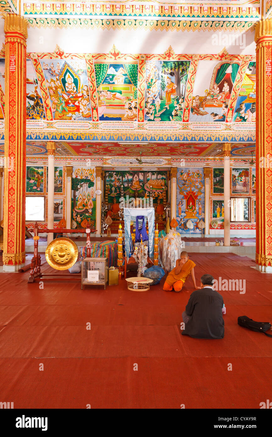 Novice Monk in the Temple That Luang in Vientiane, Laos Stock Photo
