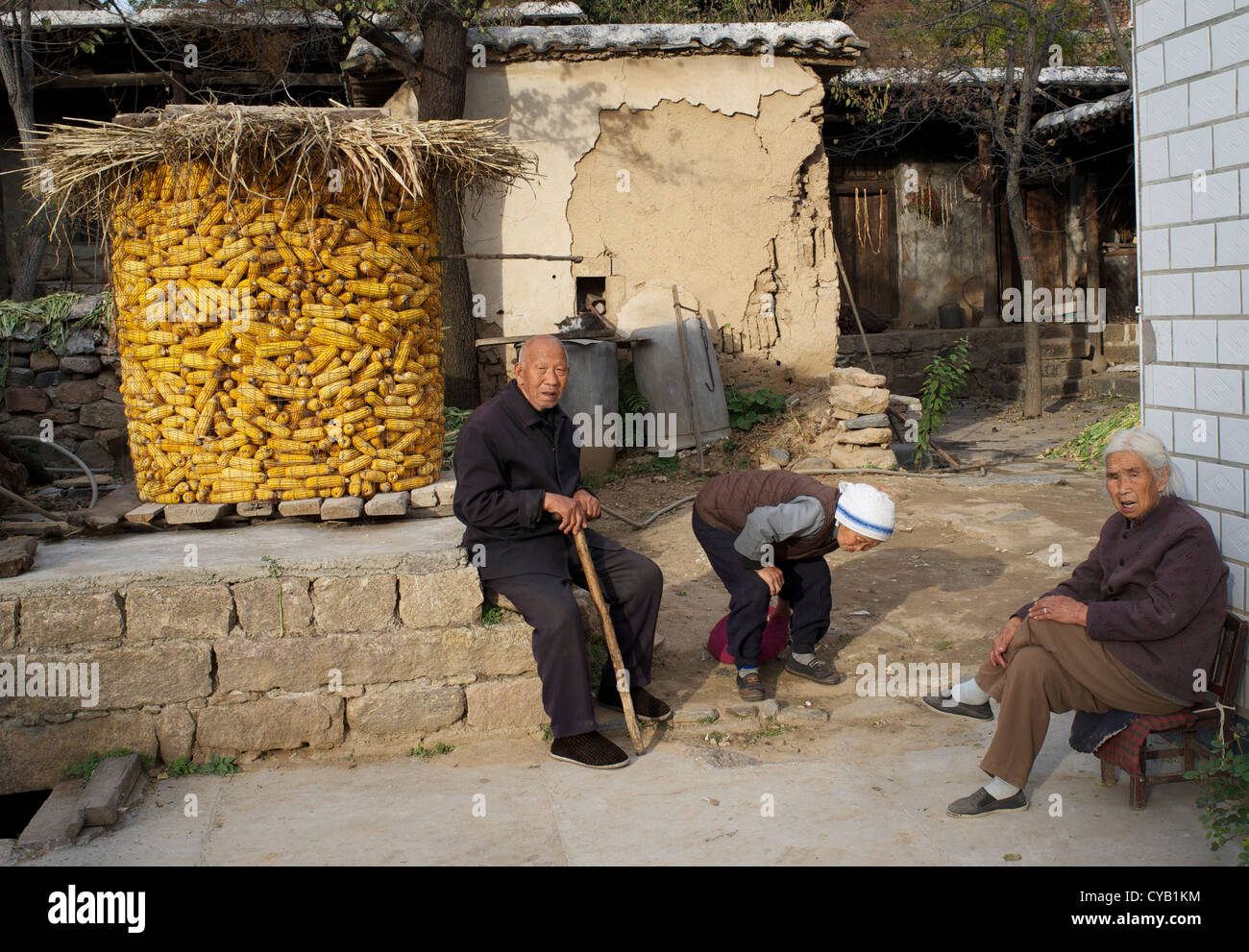 Old people rest in Laofen village, Pingshan - an officially named Poverty County, Hebei, China. 23-Oct-2012 - Stock Image