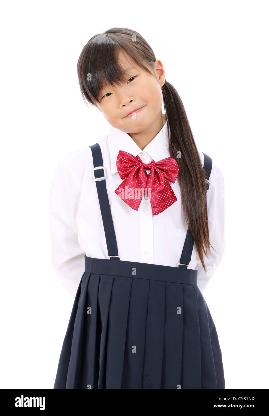Portrait Of Smiling Little Asian Schoolgirl