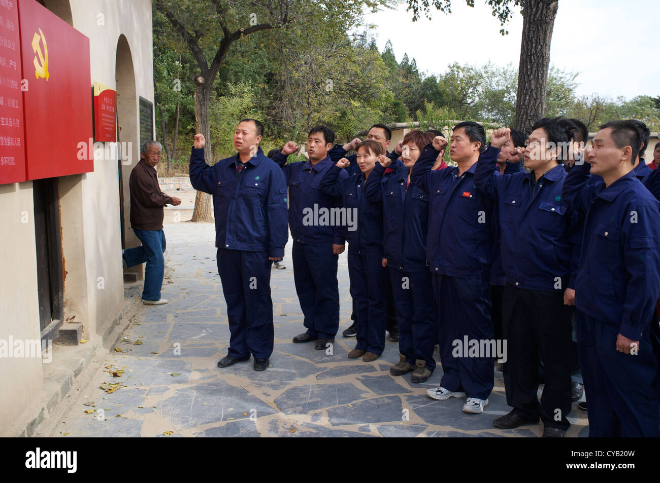 Chinese CPC members swear in front of a party flag while visiting Xibaipo, one of Red Tourism spots in China. 23 - Stock Image