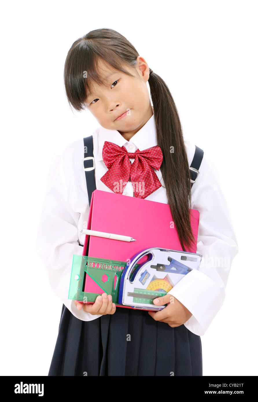 Little Asian Schoolgirl With School Supplies