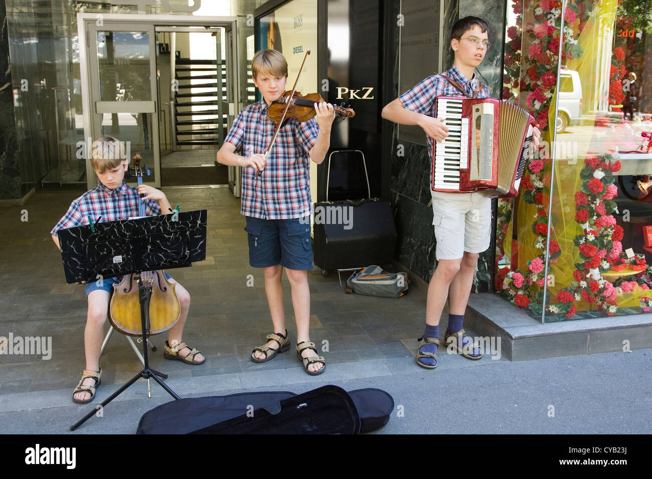 europe, switzerland, zurich, boys play music along the bahnhofstrasse - Stock Image