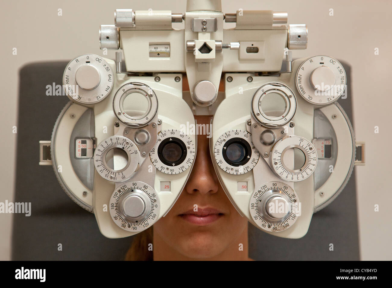 woman patient having an eye test examination on a Reichert ultramatic phoropter, autorefractometer instrument in - Stock Image