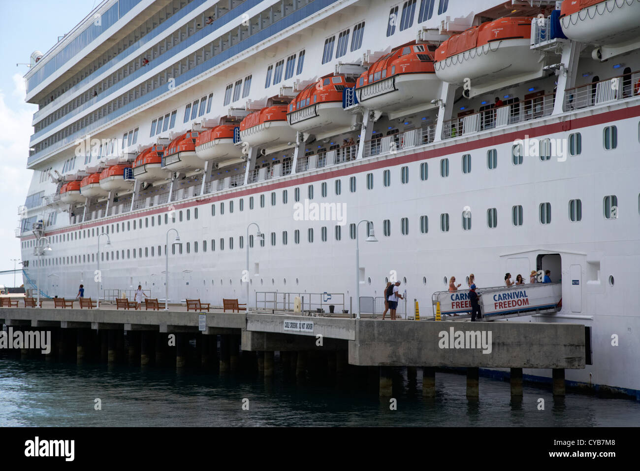 passengers boarding carnival freedom cruise ship moored key west florida usa - Stock Image