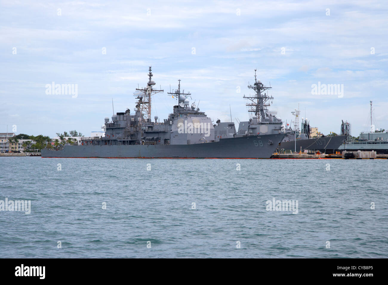 uss anzio guided missile cruiser and navy warships mole pier key west harbor florida usa - Stock Image