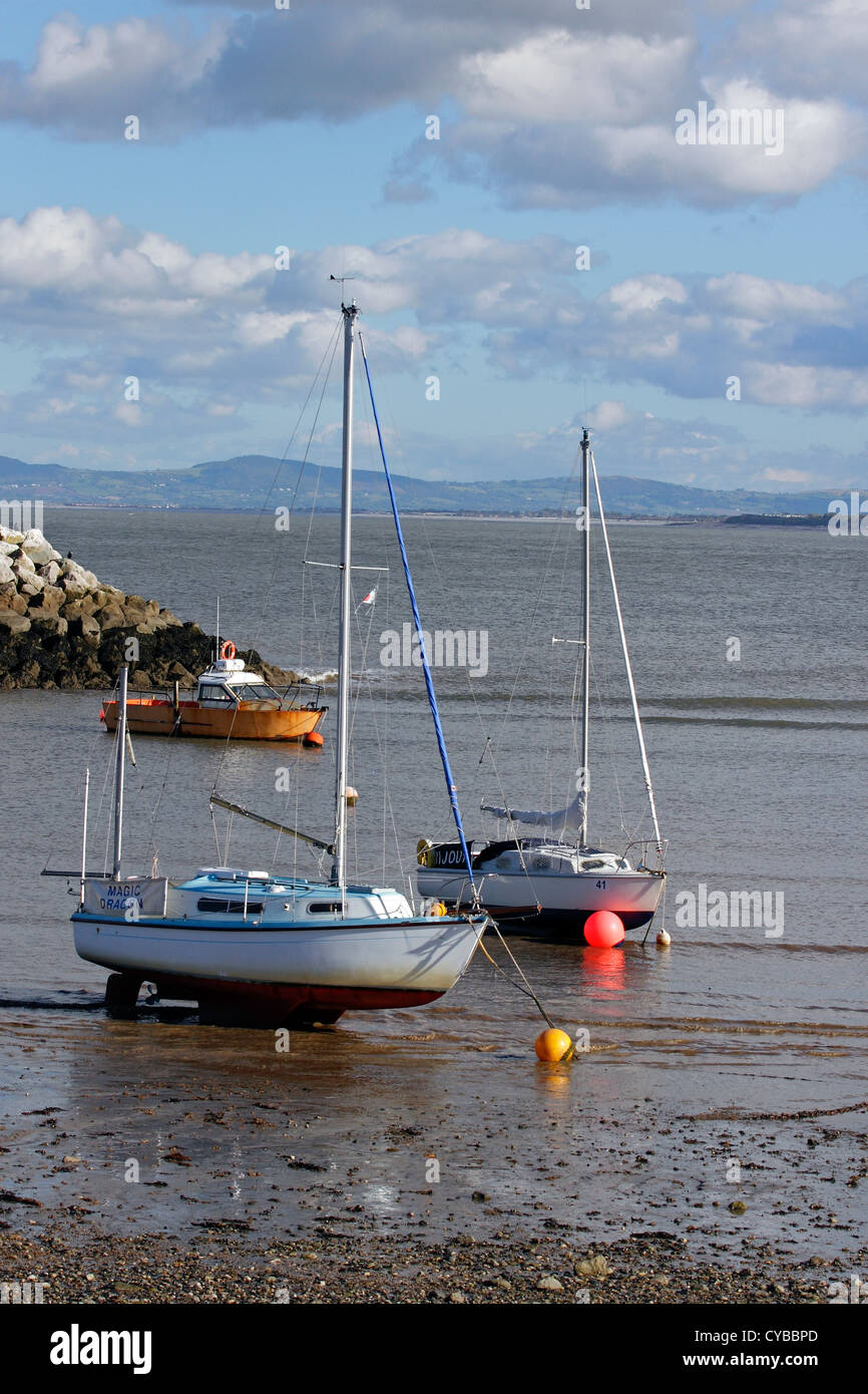 Yachts moored on the beach in Rhos on Sea, North Wales. - Stock Image