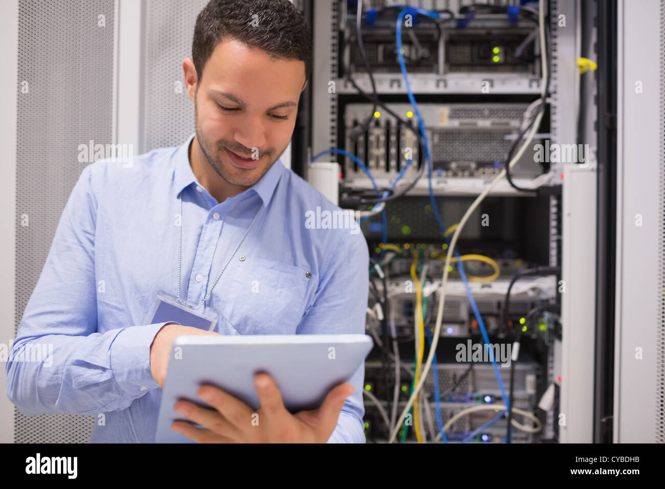 Data centre worker with tablet computer Stock Photo