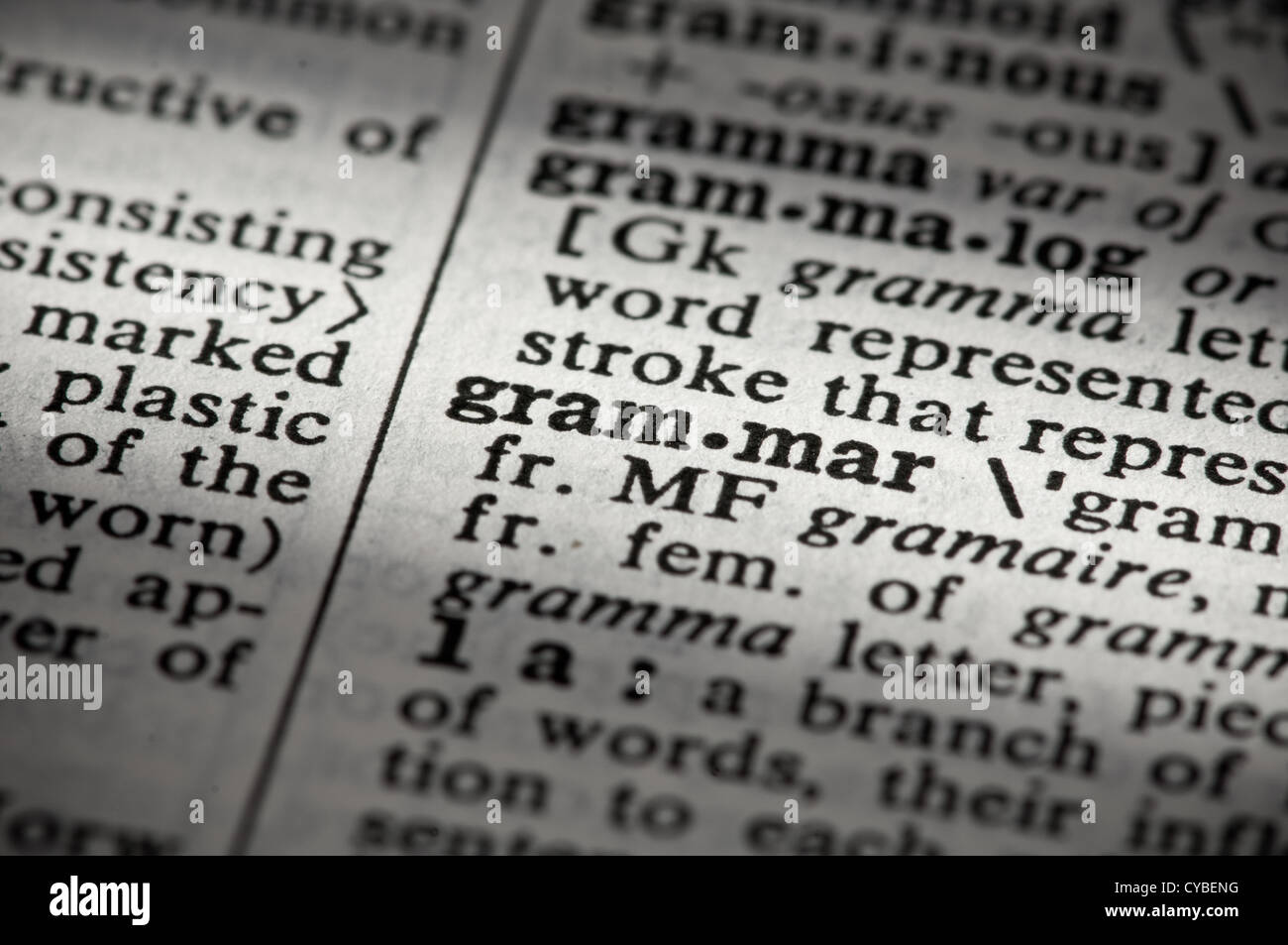 Close up of word definition in dictionary: grammar - Stock Image