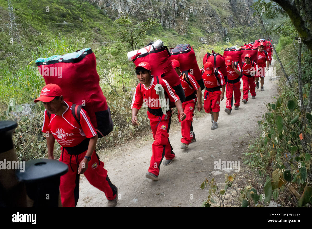 Porters carrying tourists' camping equipments on the Inca Trail to Maccu Picchu. Peru. - Stock Image
