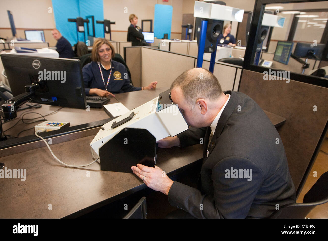 Customer in to renew driver's license gets finger-printed and Stock Photo -  Alamy
