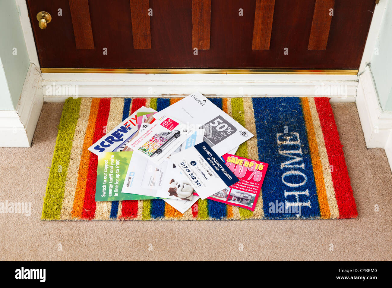 Junk mail, on a doormat in a house, UK - details changed for security - Stock Image