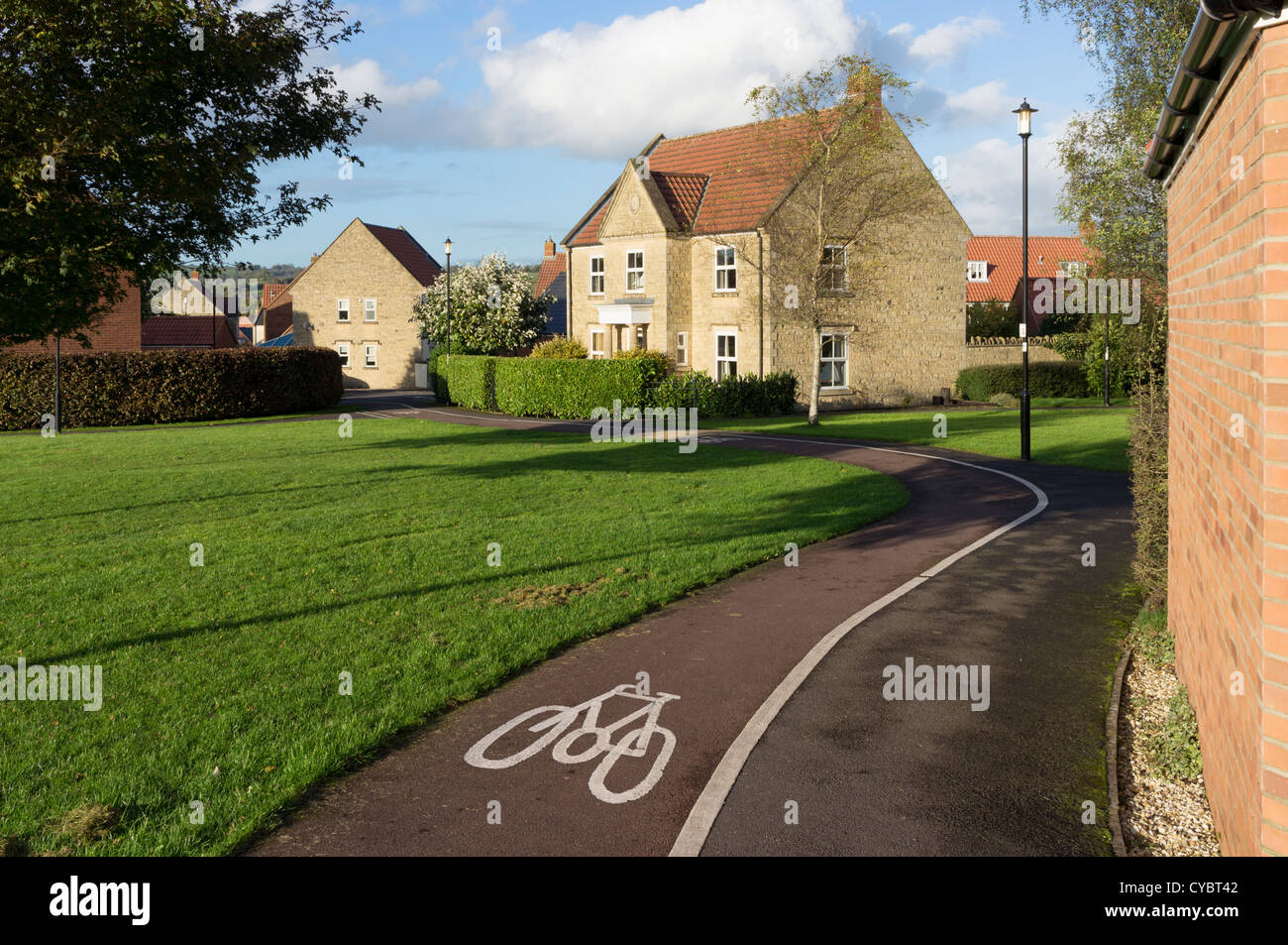 Cycle path through a housing development, England, UK - Stock Image