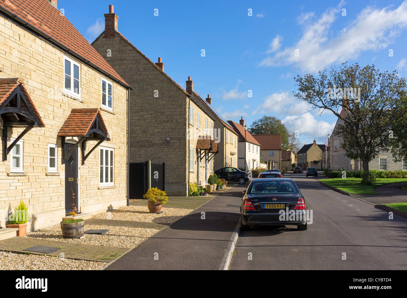 Houses in a street in a modern housing estate, UK - Stock Image