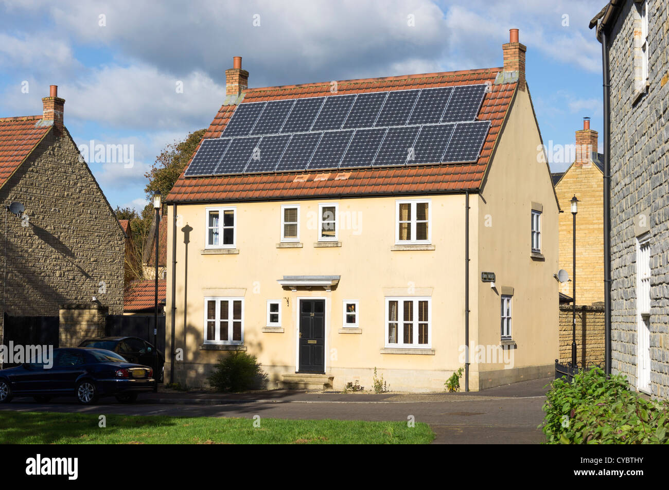 Solar panels - on a residential house, England, UK - Stock Image