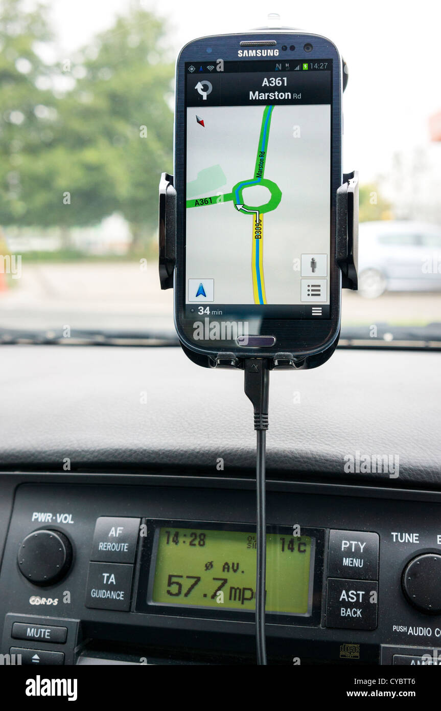 Sat nav gps on a smartphone in a car - Stock Image