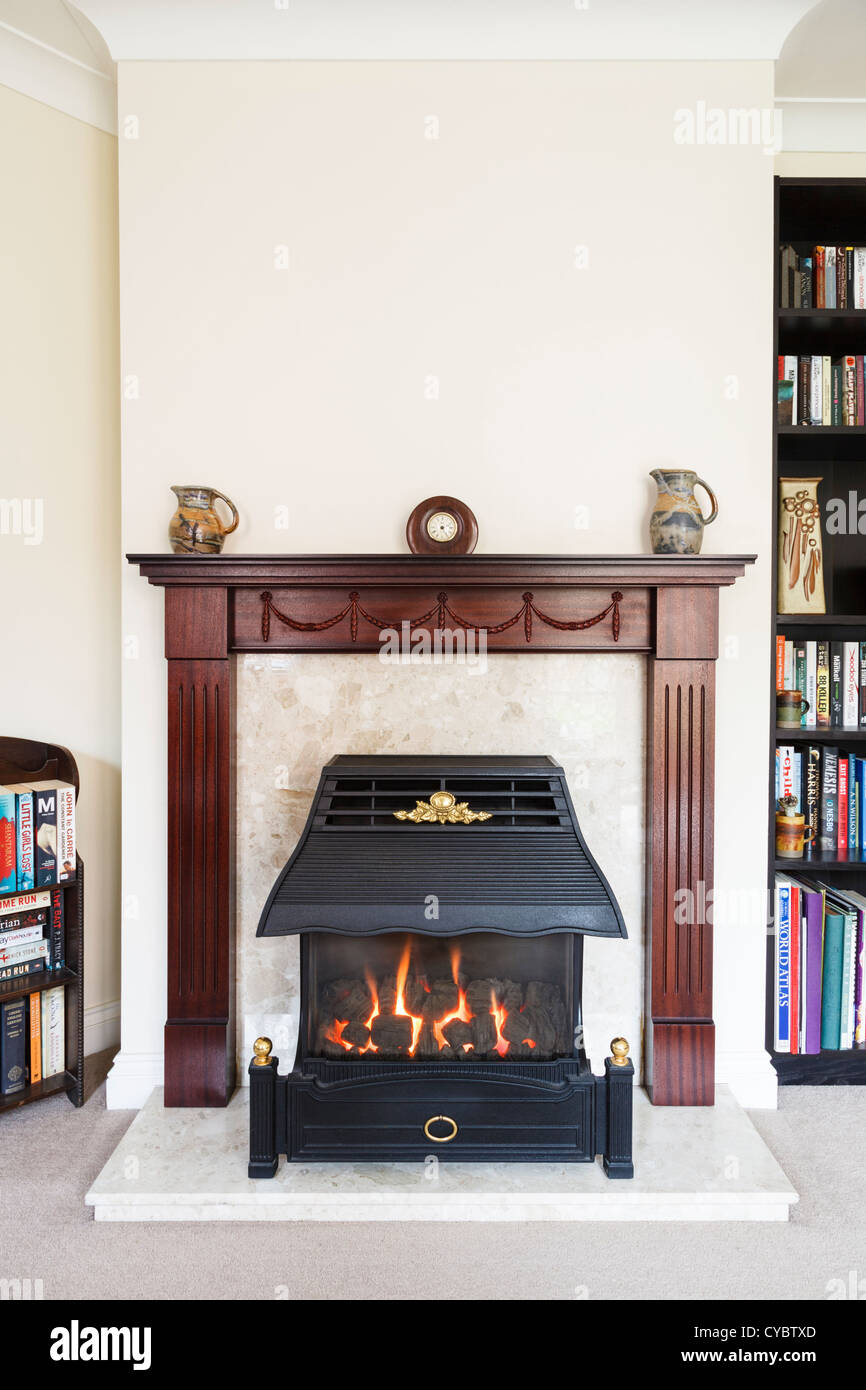 Fireplace and mantelpiece in a typical British home, UK - Stock Image