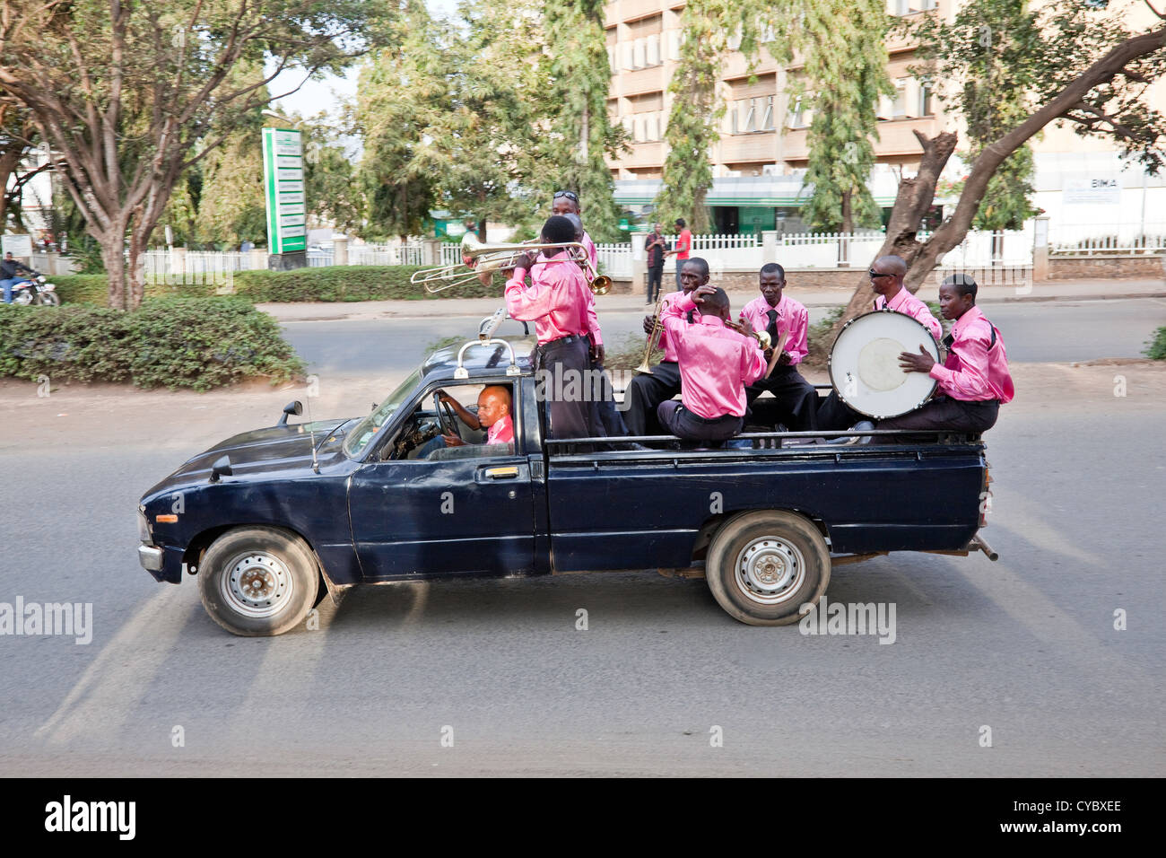 Traditional wedding ceremony with wedding party driving through the streets of Moshi;Tanzania;East Africa;Africa Stock Photo