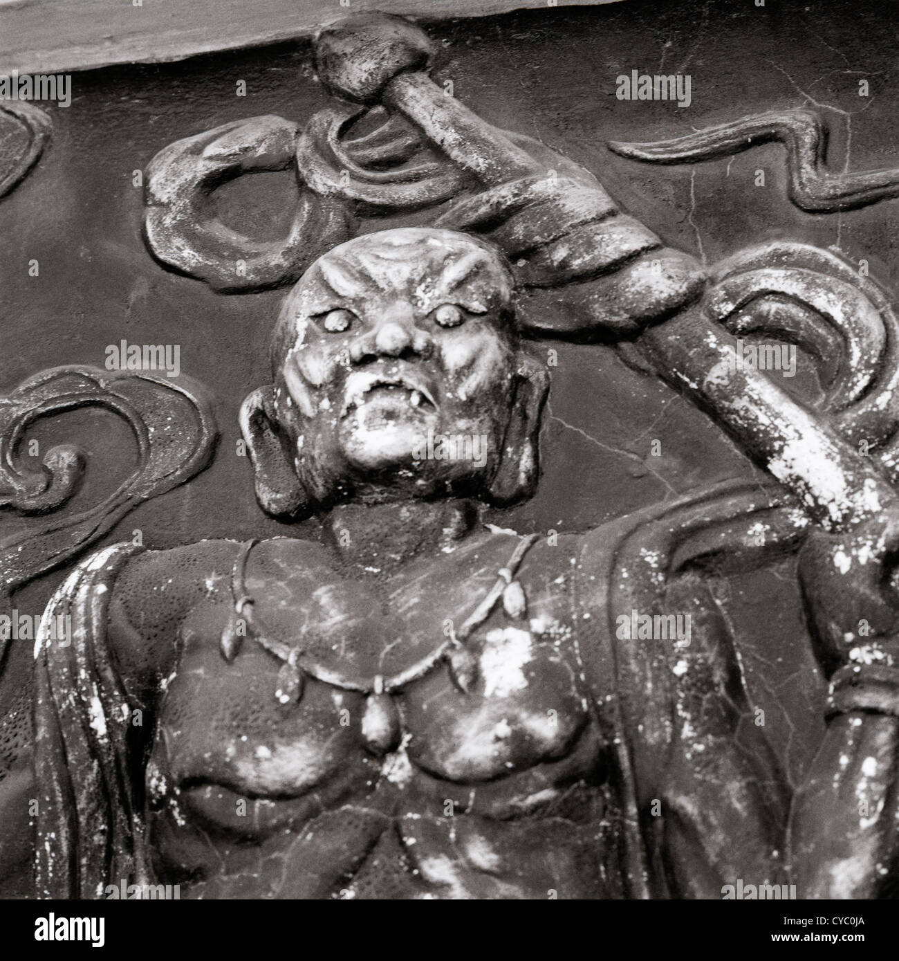 Travel Photography - Sinister carving art in Hoi An in Vietnam in Southeast Asia Far East. Religion Religious - Stock Image
