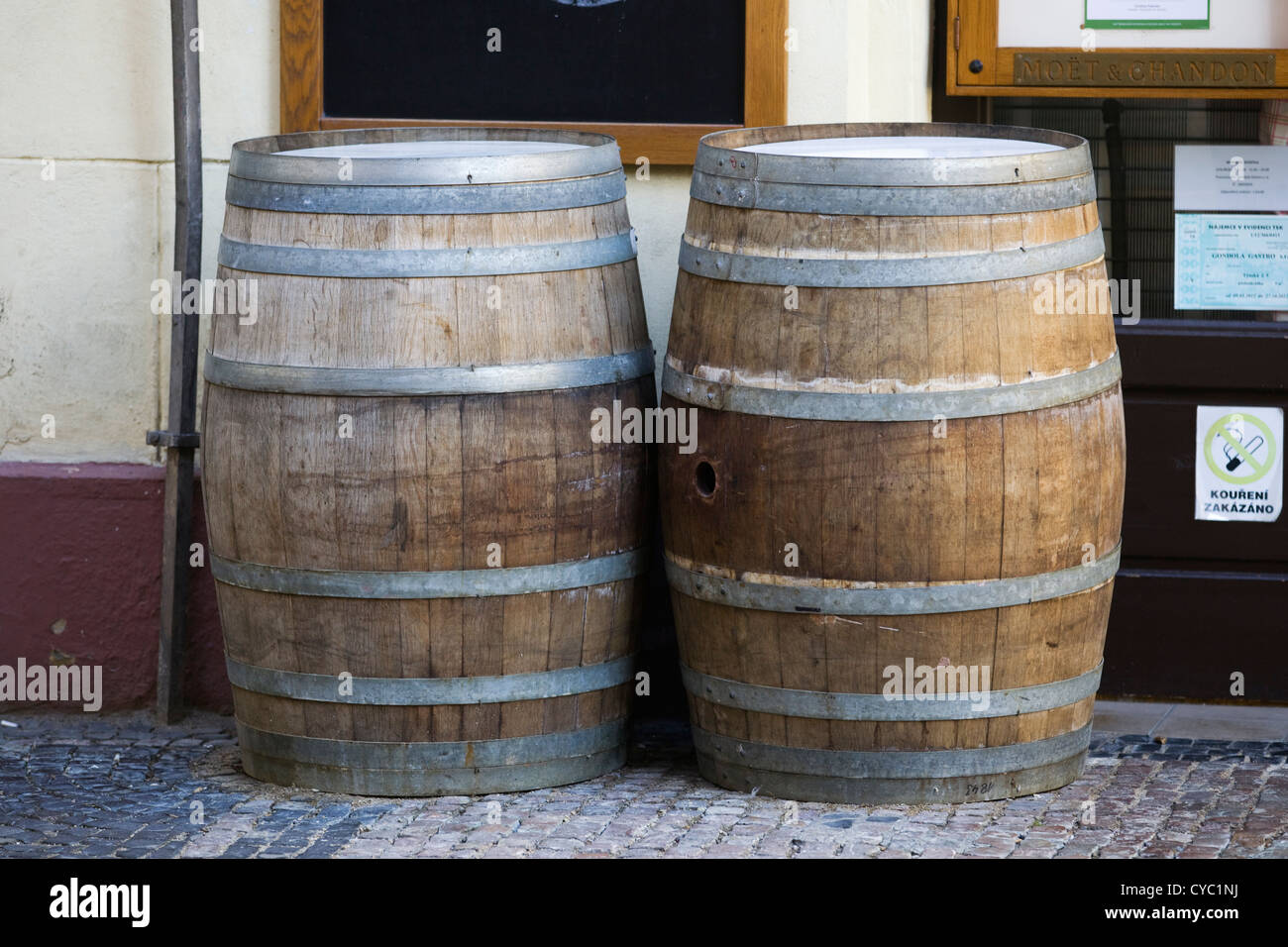 Wooden Beer barrels outside a bar - Stock Image