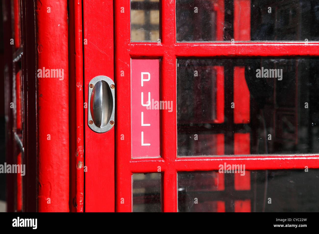A red BT telephone box in London, England, U.K. - Stock Image