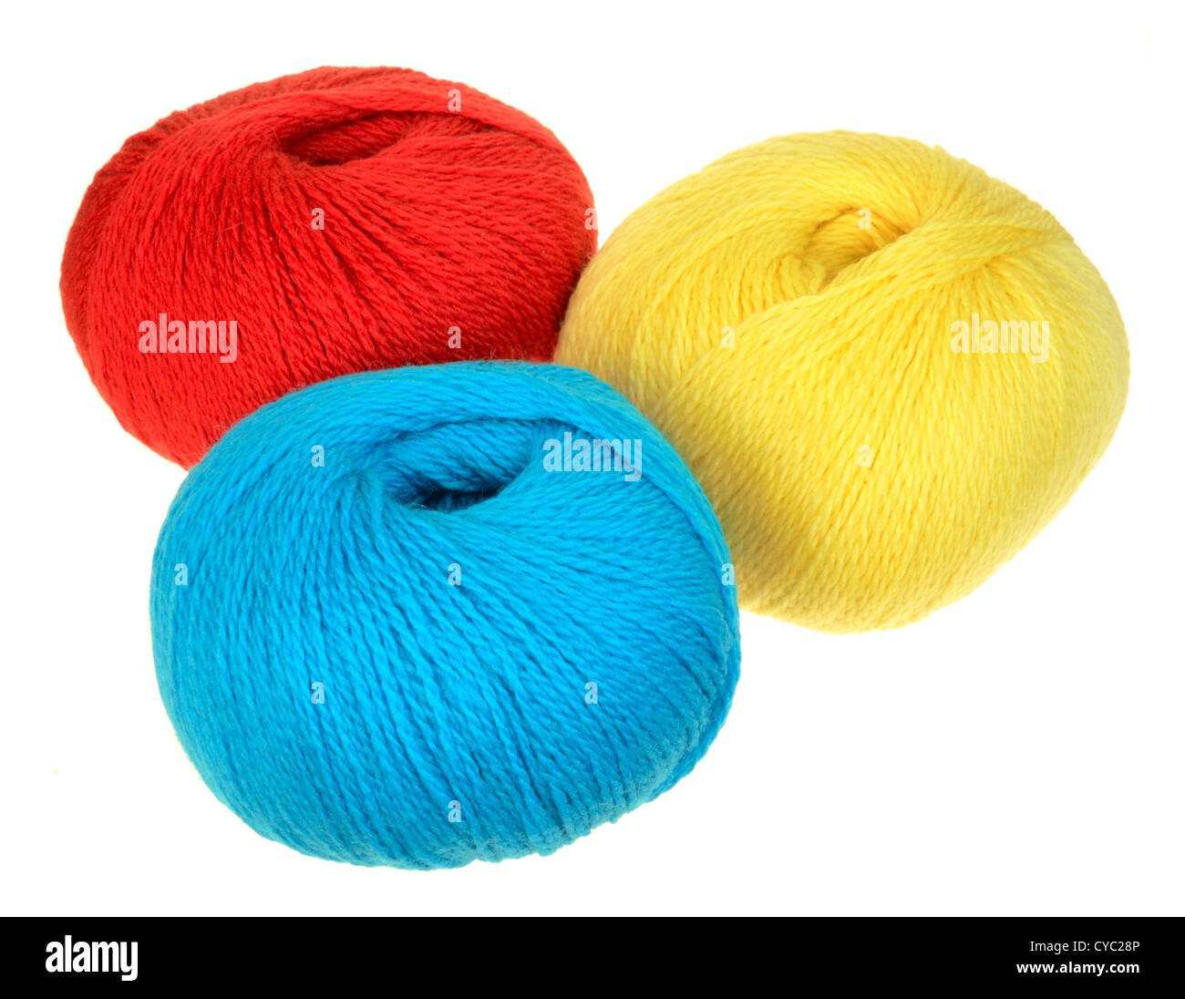 skeins of peruvian highland wool yarn in primary colors red, blue, yellow - Stock Image