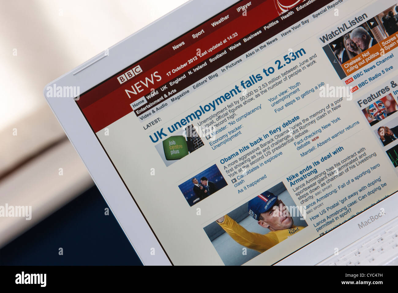 A web page from the BBC news website is photographed being viewed on a laptop computer screen. - Stock Image