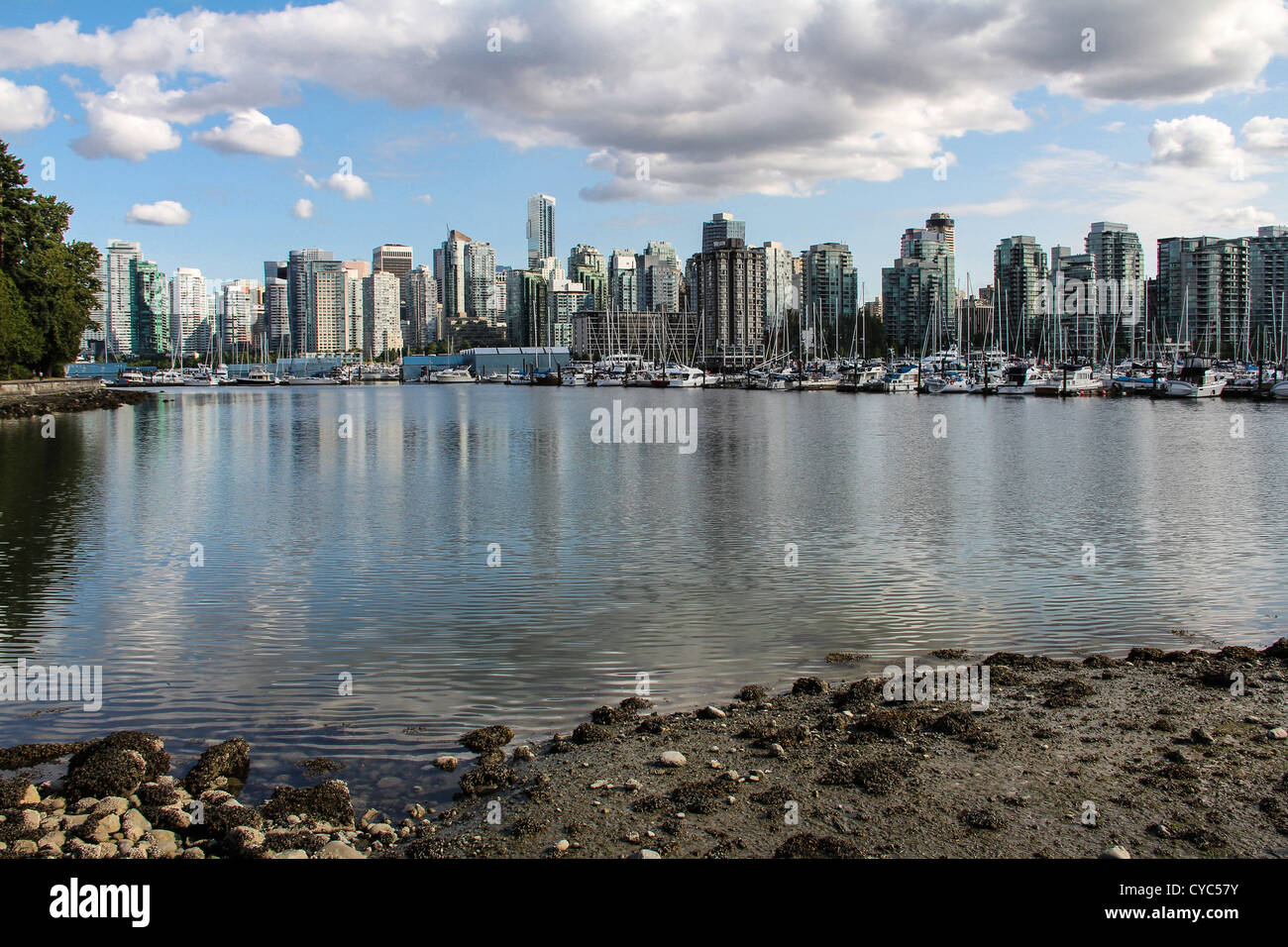Downtown Vancouver viewed over the harbour from Stanley Park - Stock Image