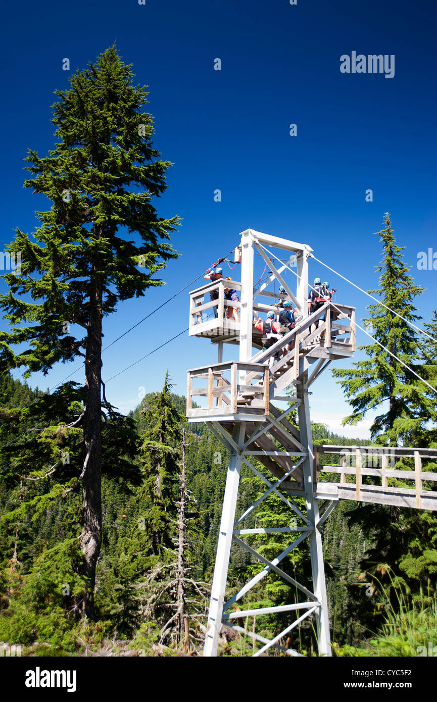 People On Platform Preparing To Go Zipline At Grouse Mountain Resort North Vancouver British Columbia Canada