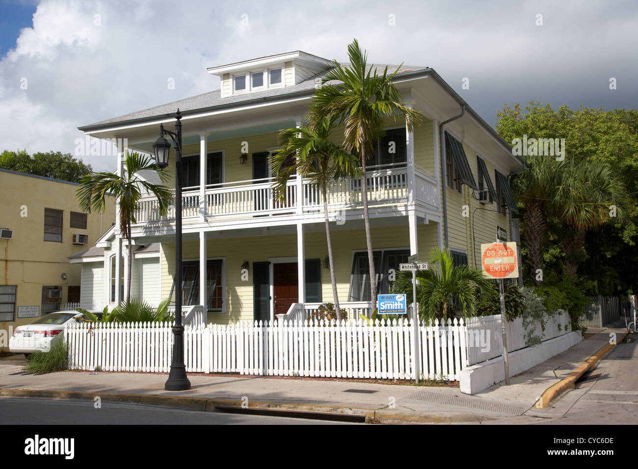 old historic wooden two storey building with white picket fence key west florida usa - Stock Image