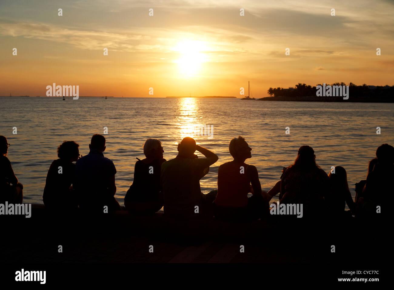 people waiting on waterfront for evening sunset celebrations mallory square key west florida usa - Stock Image