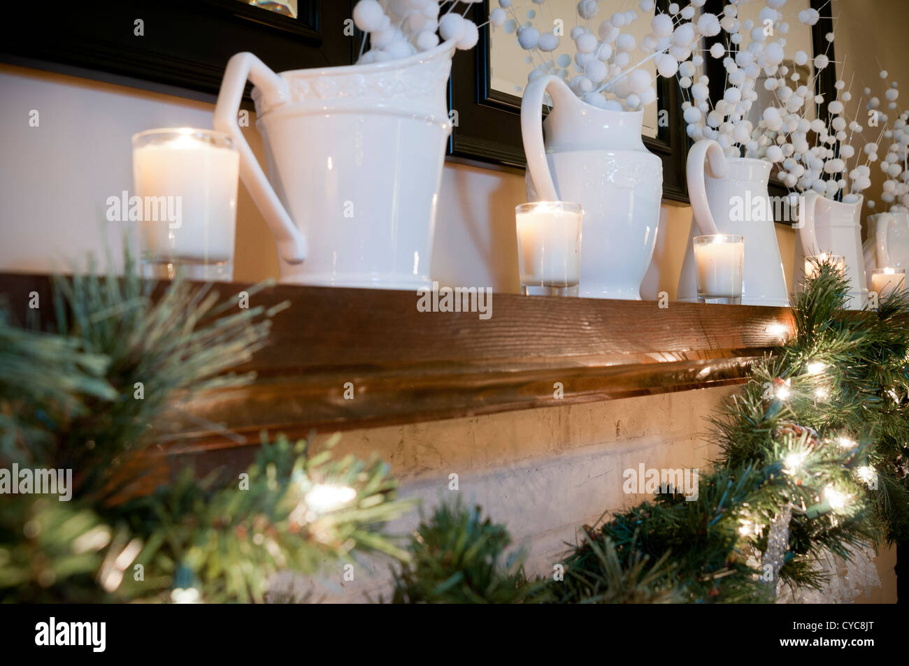 Christmas home decor around a fireplace mantle - Stock Image