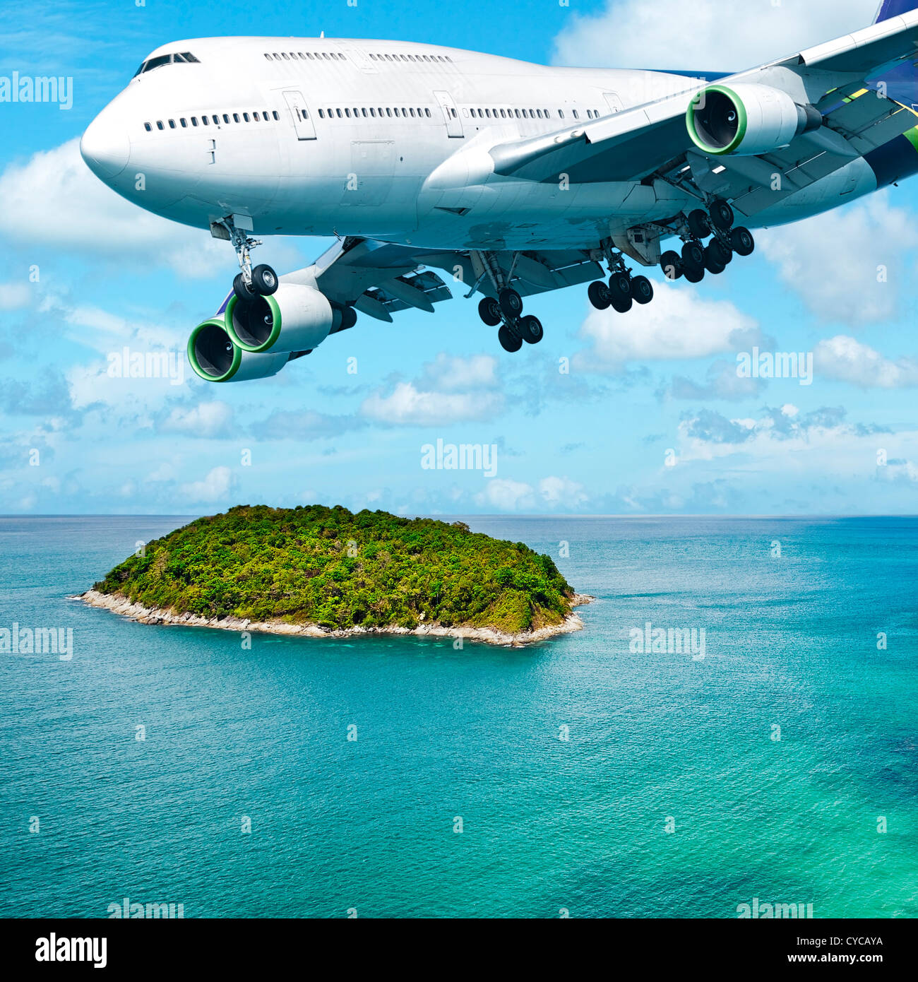Jumbo jet over the tropical island. Square composition. Stock Photo
