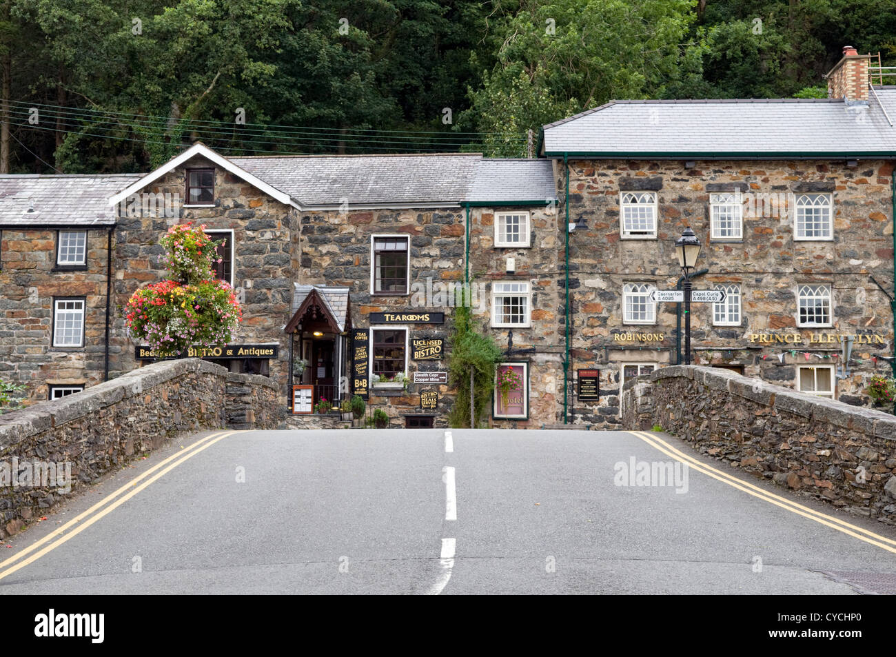 Main a498 road through the picturesque village of Beddgelert, Snowdonia, North Wales, UK - Stock Image