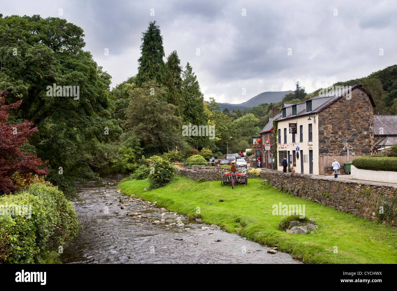 Picturesque village of Beddgelert, Snowdonia, Wales UK which is the meeting place of the two rivers Glaslyn and - Stock Image