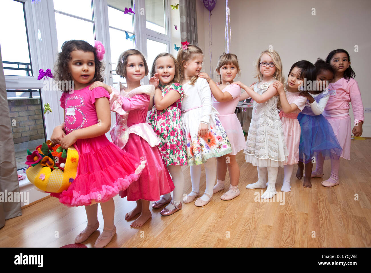 5 year old girls birthday party all dressed as in party clothes Stock Photo