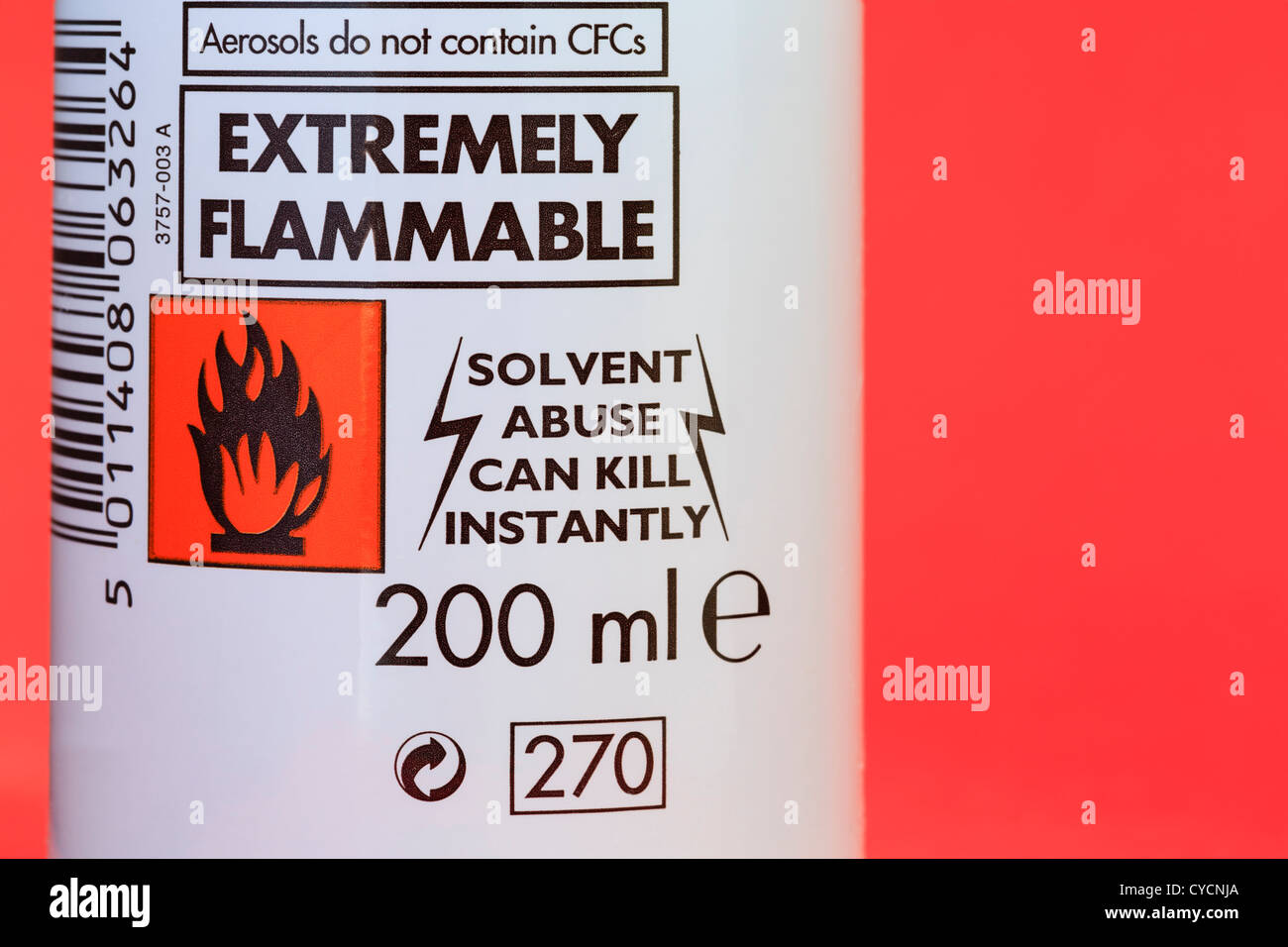 Extremely flammable symbol and solvent abuse warning label on a can of hair mousse - Stock Image