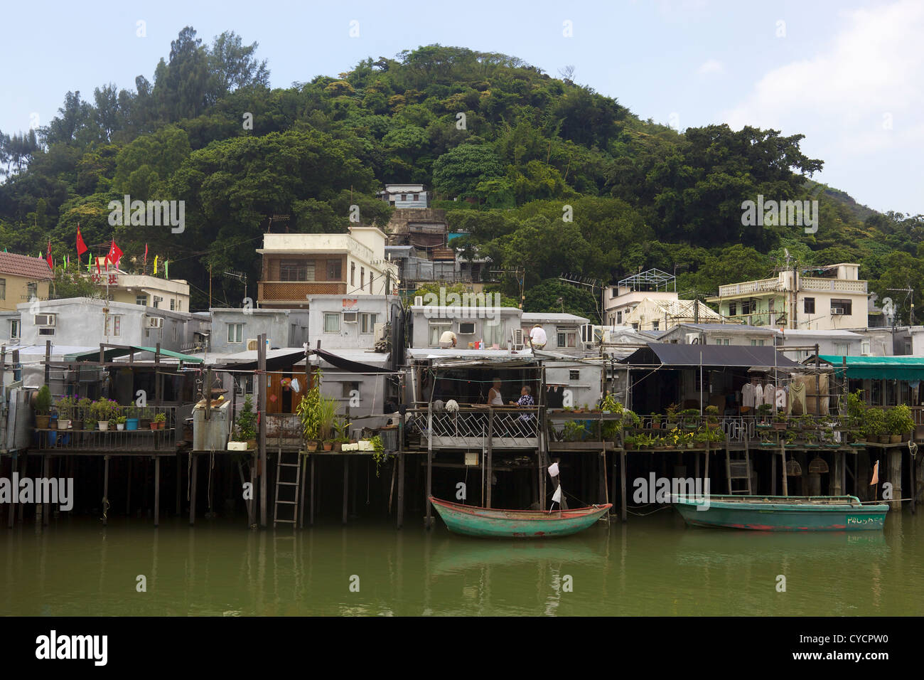 Elderly couple on the balcony of their house in Tai O fishing village. Lantau island, Hong Kong - Stock Image