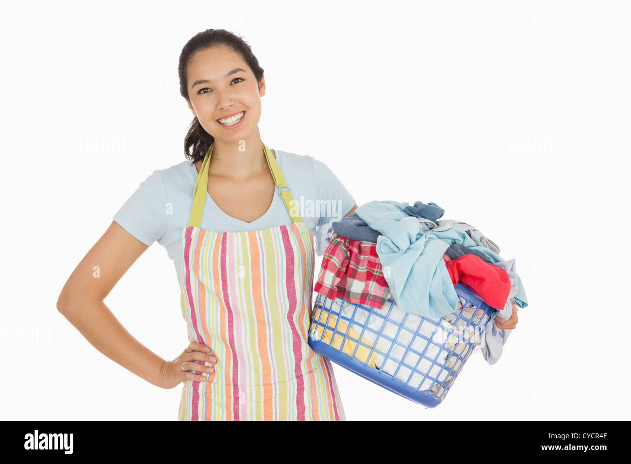 Happy woman with laundry basket - Stock Image