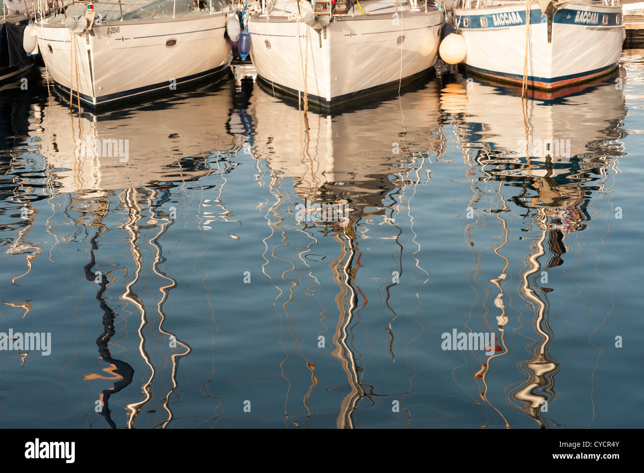 Reflections of yacht masts in the harbour water at Puerto de Mogan Gran Canaria Canary Islands Spain - Stock Image