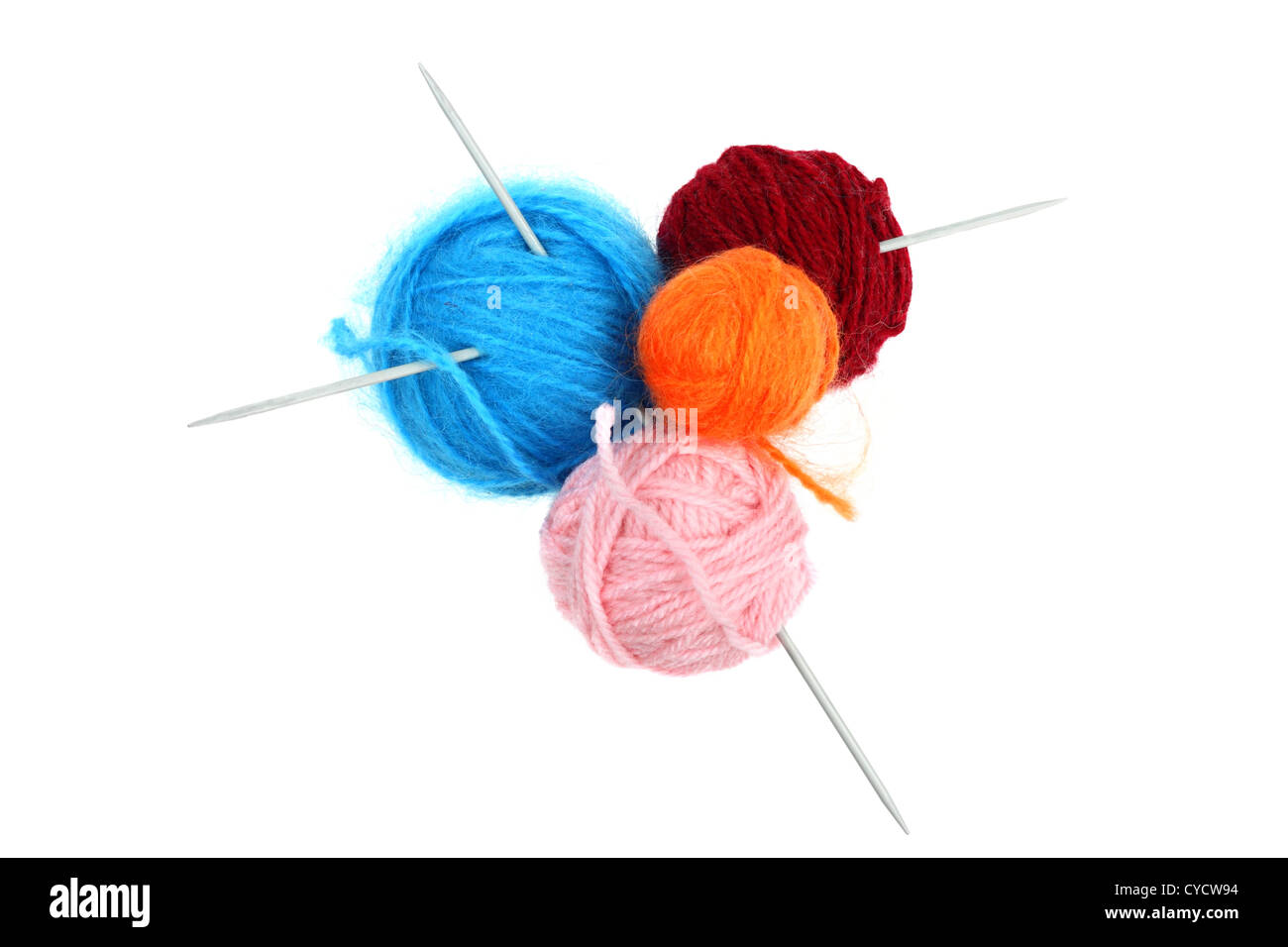 Balls of colorful wool yarn with knitting needles isolated on white - Stock Image