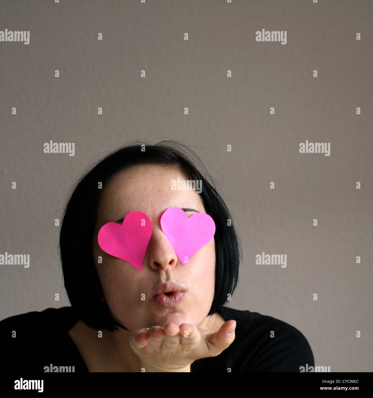loving,pink glasses,blow a kiss Stock Photo