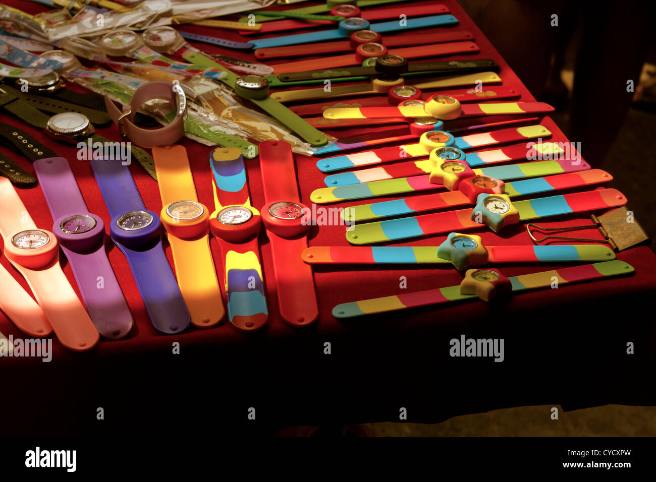 Wristwatches in a row on market stall table - Stock Image