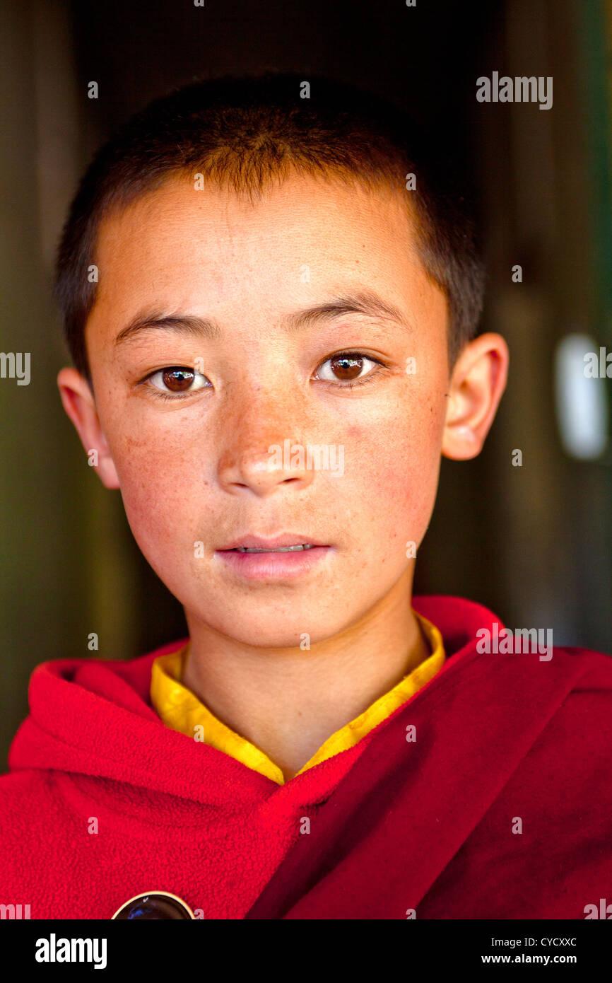 A novice monk at Hemis Monastery in India. - Stock Image