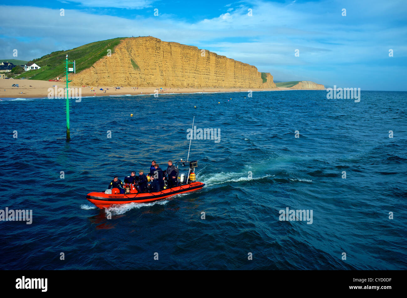 RIB passing East Cliff on its return to West Bay Harbour,  Dorset UK - Stock Image