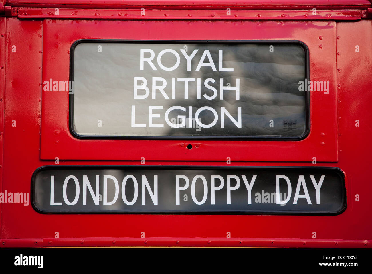 Royal British Legion London Poppy Day Poppy Appeal, Advertised on a London Routemaster Bus window, London, United - Stock Image