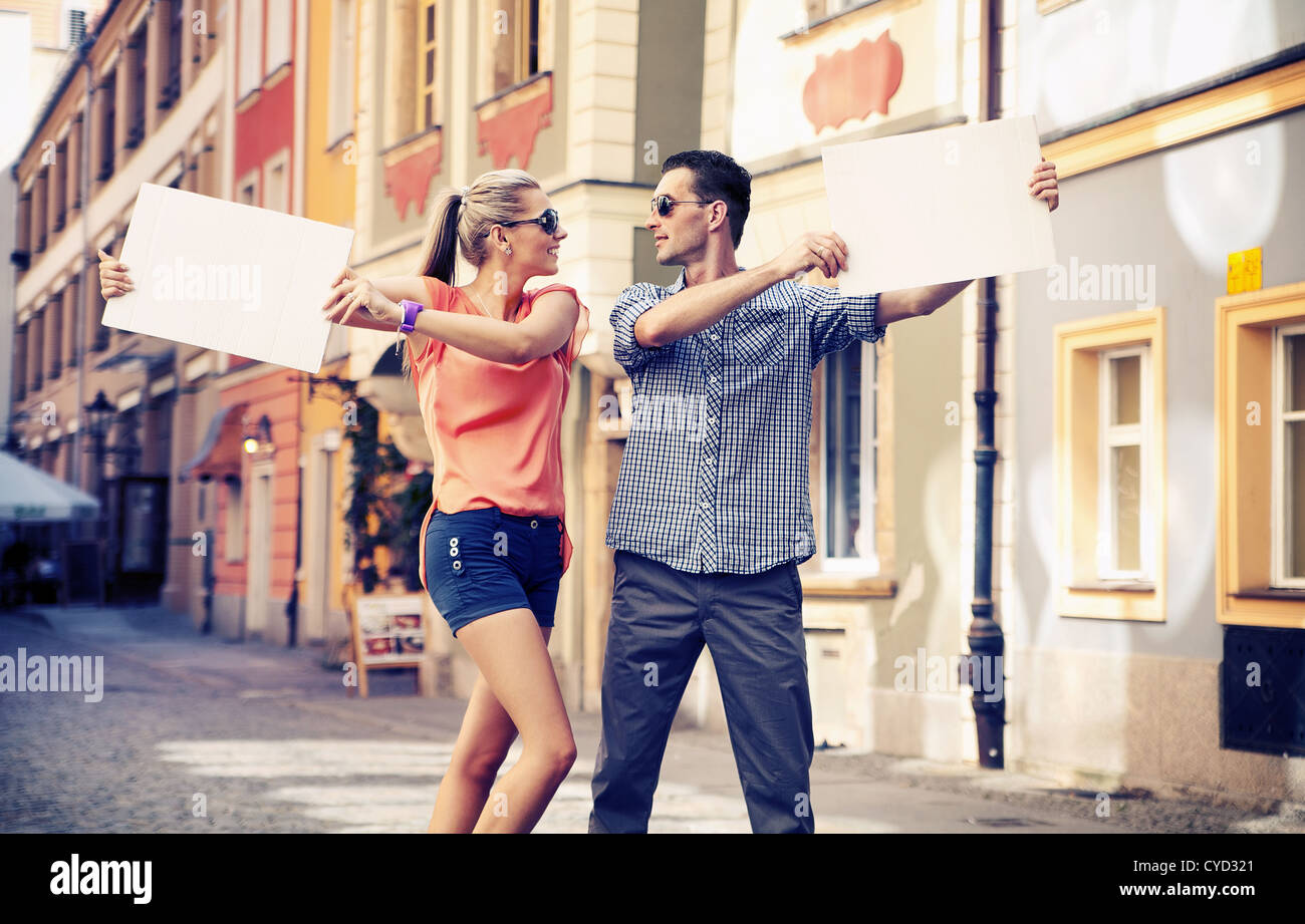 Cute couple with advertise - Stock Image