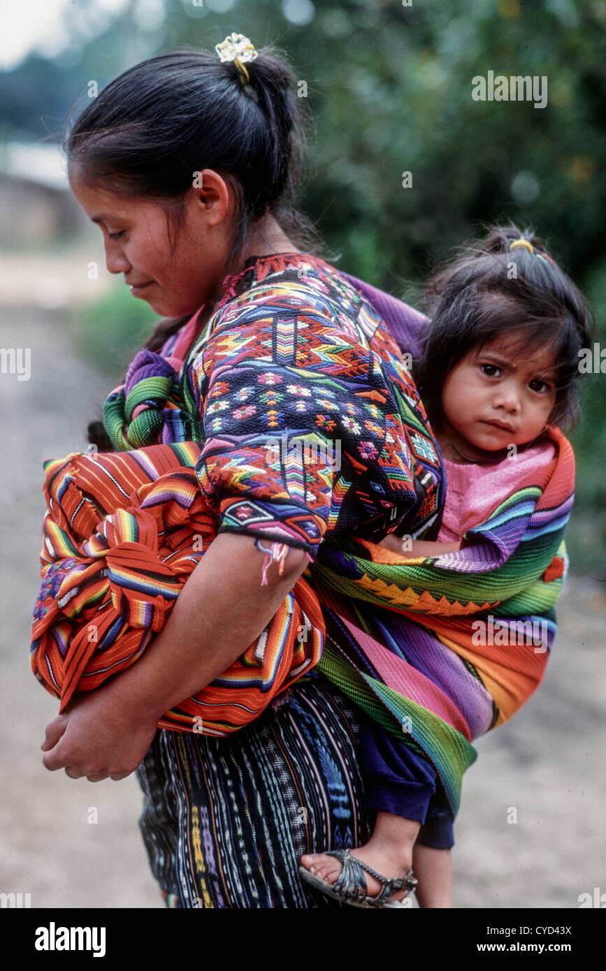 Guatemalan Mayan mother in traditional dress with baby ...