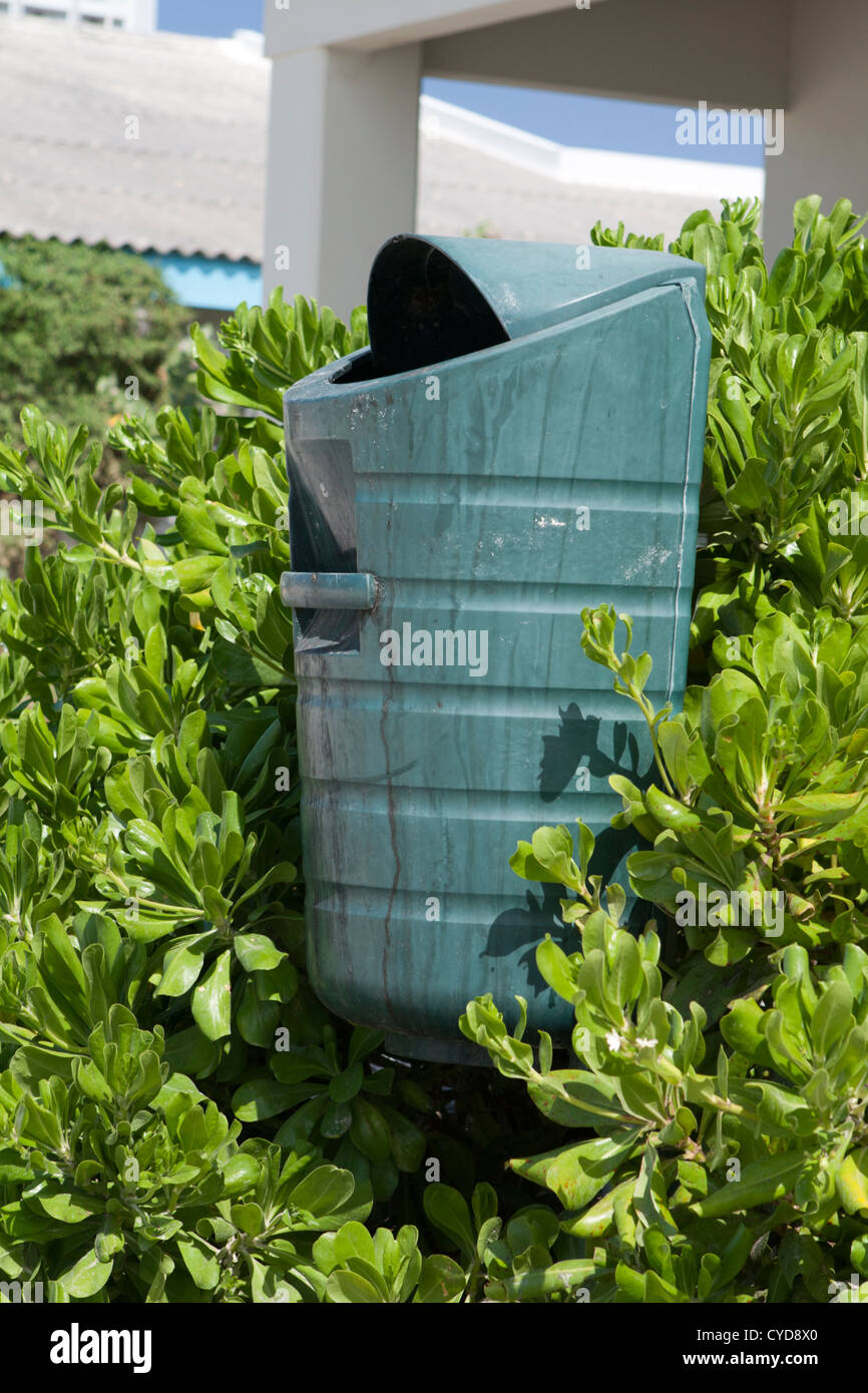 trash can along public board walk Aruba - Stock Image