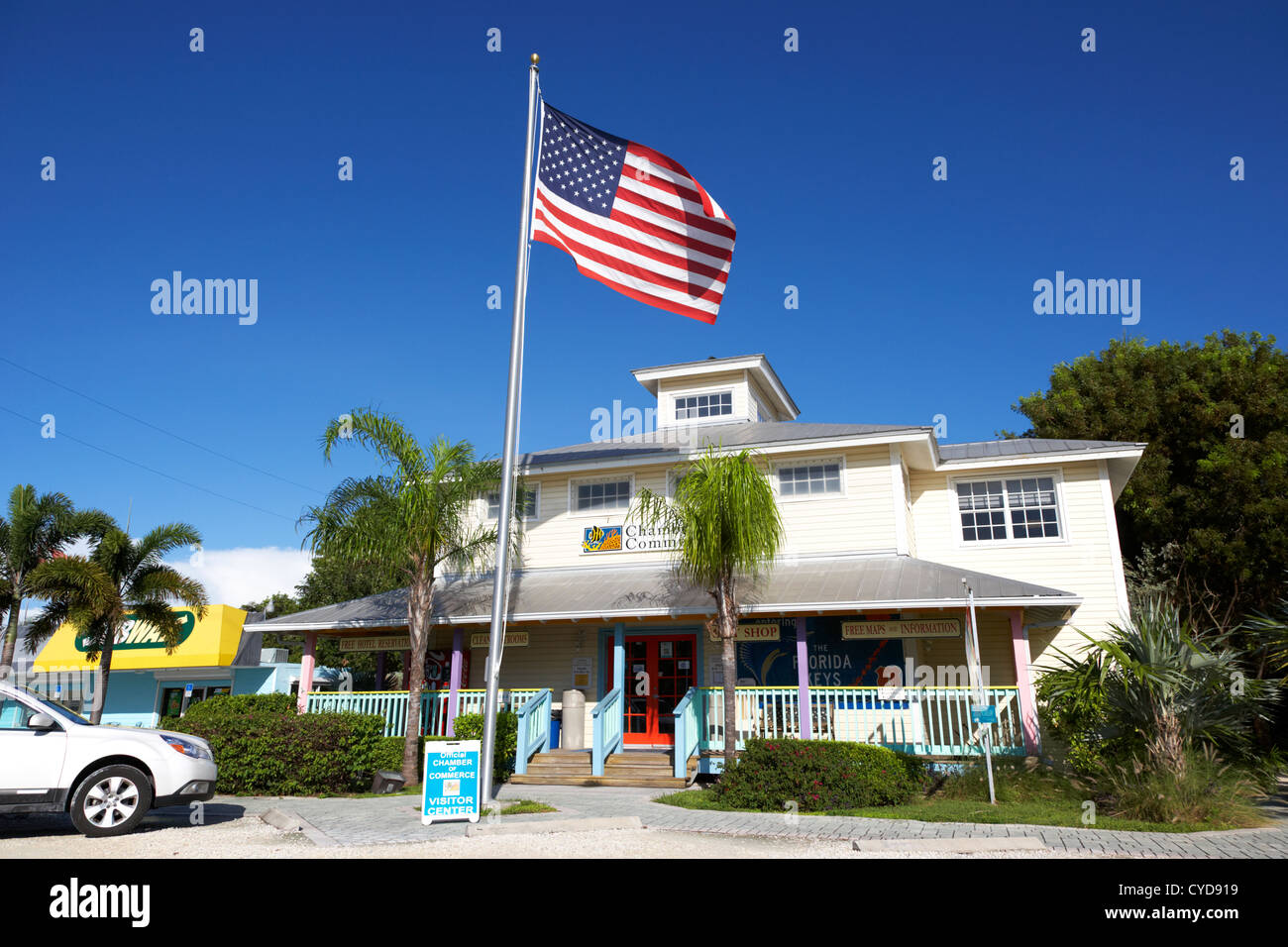 american flag on a flagpole outside the chamber of commerce building in key largo florida keys usa - Stock Image