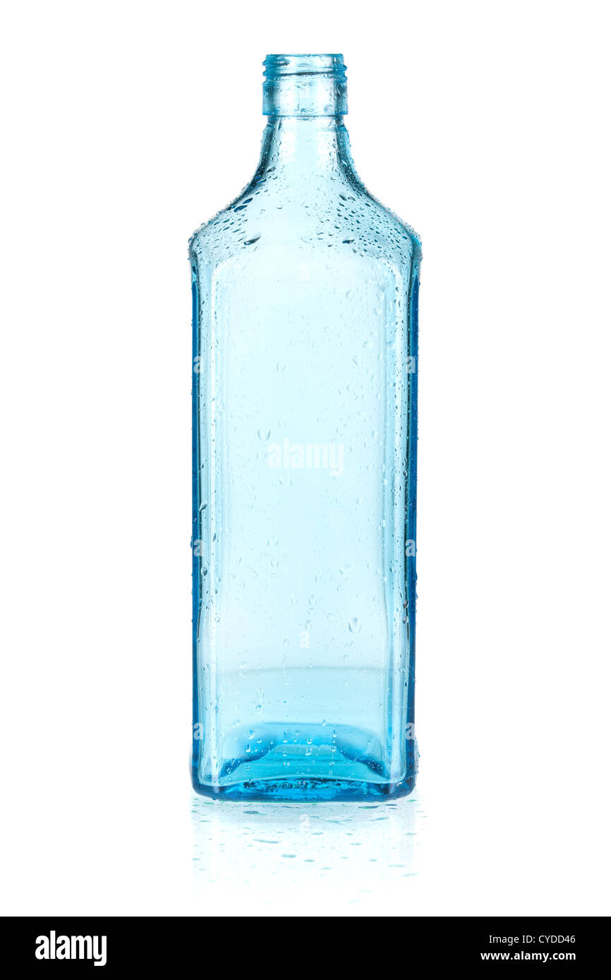 Blue empty bottle with water drops. Isolated on white background Stock Photo